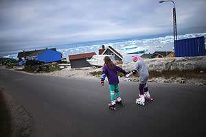 Children rollerskate through Ilulissat's streets