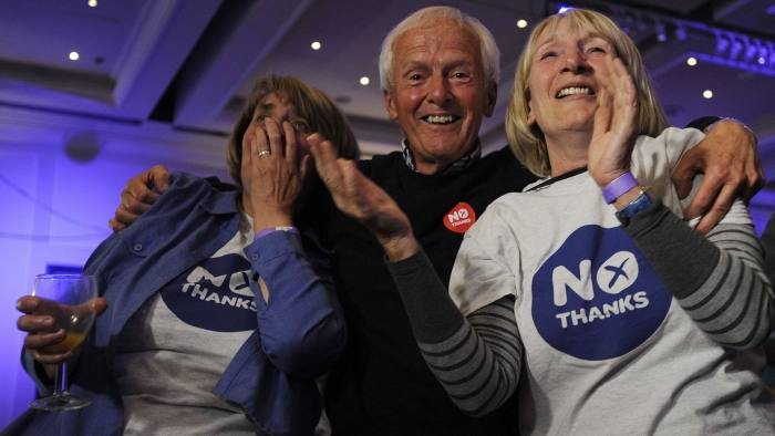 Pro-union supporters react as Scottish independence referendum results come in at a Better Together event in Glasgow