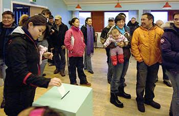 Greenlanders vote in a referendum on self-rule in November 2008