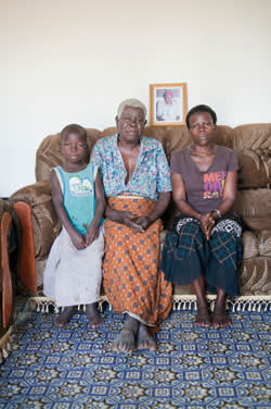 Jacqueline, the estranged 'bush wife' of Michael, with her grandmother and daughter, at the family home in Gulu
