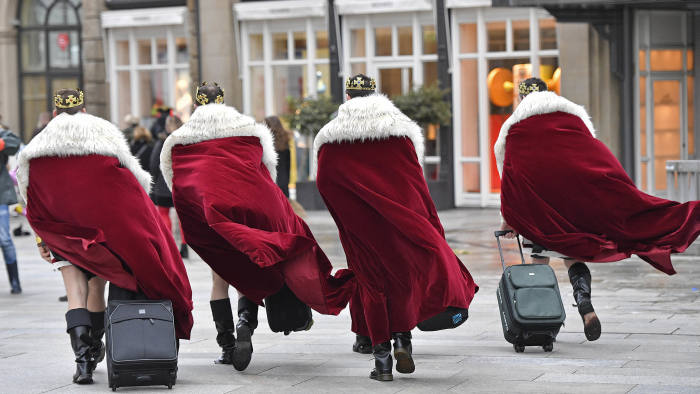 Four men dressed as kings arrive in the city center when tens of thousands revelers dressed in carnival costumes celebrate the start of the street-carnival in Cologne, Germany, Thursday, Feb. 23, 2017. (AP Photo/Martin Meissner)