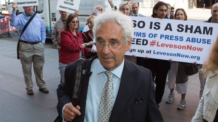IPSO protest...The chairman of the new press self-regulation body Sir Alan Moses enters the OCC HQ as Hacked Off campaigners hold banners in a protest to oppose the new regulator IPSO and deliver an open letter to Sir Moses. PRESS ASSOCIATION Photo. Picture date: Monday September 8, 2014. See PA story MEDIA IPSO. Photo credit should read: Daniel Leal-Olivas/PA Wire