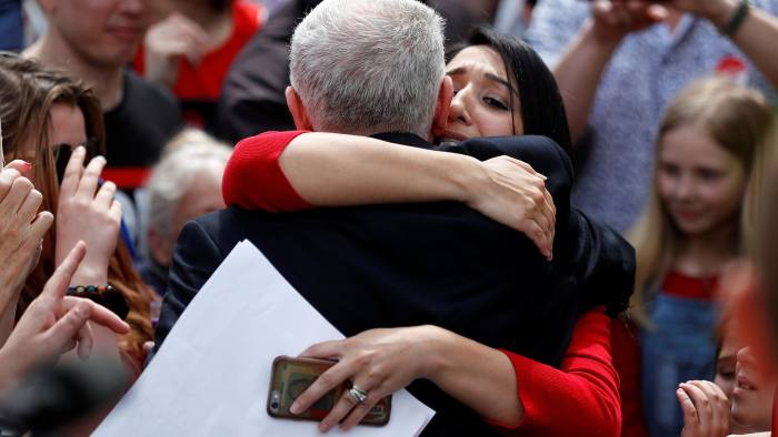 A woman embraces Jeremy Corbyn, leader of Britain's opposition Labour Party, at a campaign event in Reading, May 31, 2017. REUTERS/Peter Nicholls TPX IMAGES OF THE DAY