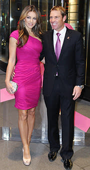 Shane Warne with then fiancée Liz Hurley in 2011