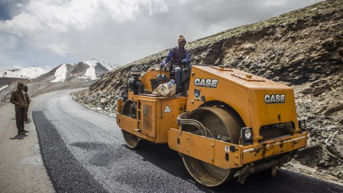 A Border Roads Organisation (BRO) worker drives a steamroller while repairing a road surface with tarmac on a section of the Leh Manali highway in Ladakh region, Jammu and Kashmir, India, on Saturday, Aug. 8, 2015. India is scheduled to release second-quarter gross domestic product figures on Aug. 31. Photographer: Prashanth Vishwanathan/Bloomberg