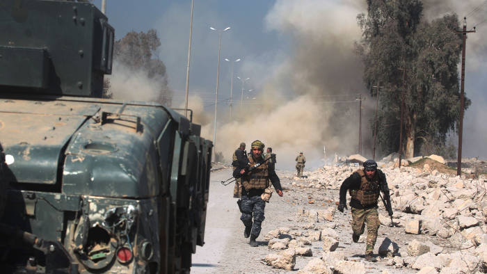 TOPSHOT - Smoke billows as Iraqi forces attack Mosul airport during an offensive to retake the western side of the city from jihadists of the Islamic State group on February 23, 2017. Iraqi forces entered Mosul airport, which lies on the southern edge of the city, for the first time since the Islamic State group overran the region in 2014. Control of the base and airport would set government forces up to enter Mosul neighbourhoods on the west bank of the Tigris, a month after declaring full control of the east bank. / AFP PHOTO / AHMAD AL-RUBAYEAHMAD AL-RUBAYE/AFP/Getty Images