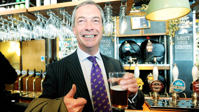 United Kingdom Independence Party (UKIP) leader, Nigel Farage enjoys a celebratory pint of beer in a pub in central London
