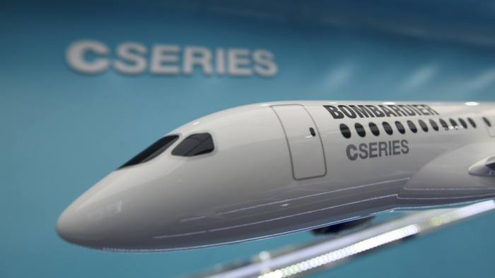 A model of Bombardier Inc.'s new C series passenger aircraft sits on display at the company's stand on the second day of the Farnborough International Air Show in Farnborough, U.K., on Tuesday, July 10, 2012. The Farnborough International Air Show runs from July 9-15. Photographer: Chris Ratcliffe/Bloomberg