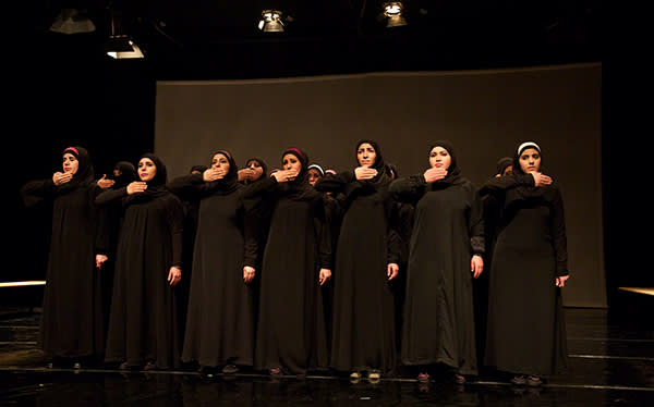 Syrian women on stage in Amman, Jordan, for their production of Euripides' 'The Trojan Women'