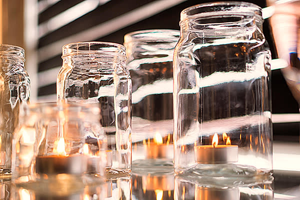 F6P49Y Candles in glass jars