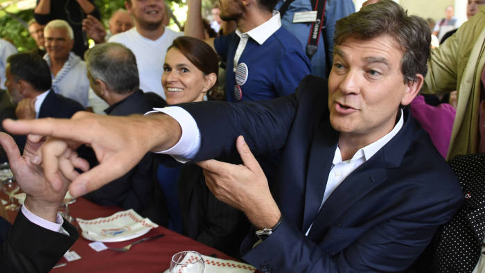Former French Minister Arnaud Montebourg (C) gestures next to Former French Minister of Culture Aurelie Filippetti (C-L) at the 44th annual Fete de la Rose political meeting on August 21, 2016 in Frangy-en-Bresse