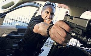 Jake Gyllenhaal and gun in 'End of Watch' (2012)