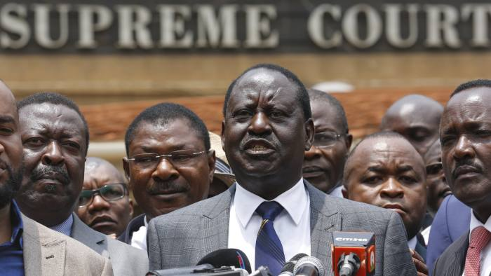 Kenyan opposition leader Raila Odinga speaks outside the country's Supreme Court after it annulled the results of the August election