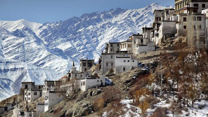 The monastery amid snow-covered mountains
