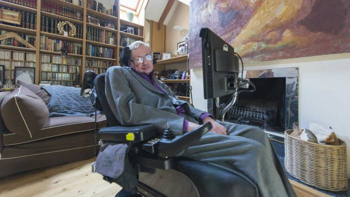 Hawking in his library at home.JPG