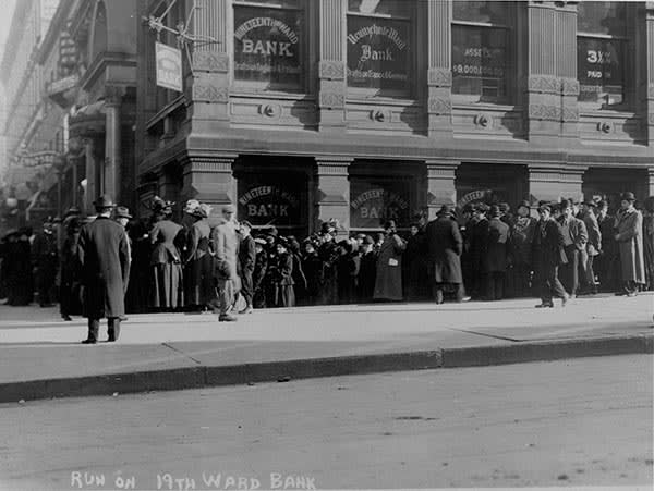 A crowd gathers outside of the Nineteenth Ward Bank as people run on the bank. ca. 1907-1914, New York City. (Photo by George Grantham Bain/Library of Congress/Corbis/VCG via Getty Images)