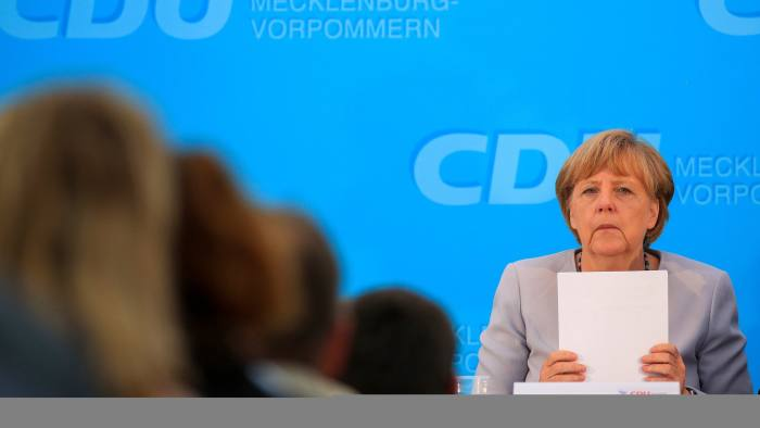 Angela Merkel, Germany's chancellor, pauses during an election campaign event in Boldekow, Germany, on Thursday, Aug. 18, 2016. Merkel said fighting crime and Islamist terror will be key challenges for years, adopting a law-and-order stance after attacks in Germany eroded her approval rating. Photographer: Krisztian Bocsi/Bloomberg
