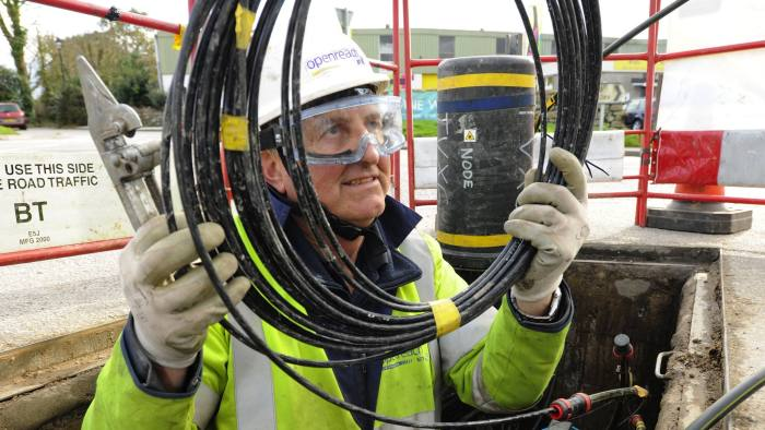 Openreach engineer laying fibre broadband cable