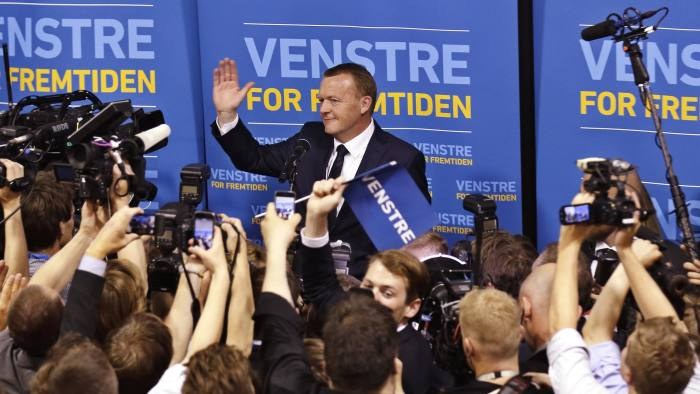 Lars Loekke Rasmussen, head of the Liberal Party, waves at his supporters and the media after the result of the election became clear early Friday morning, June 19. 2015 at the Parliament in Christiansborg Castle in Copenhagen. Denmark's center-right opposition won a parliamentary election after strong gains by an anti-immigration party that wants to limit the European Union's influence over the small Nordic country. With all votes counted, preliminary official results showed the opposition bloc led by Loekke Rasmussen, a former prime minister, would get the 90 seats needed to secure a majority in the 179-seat legislature. (Jens Dresling/Polfoto via AP) DENMARK OUT