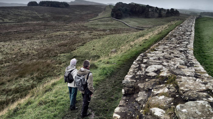 Hikers near the Roman fort at Housesteads