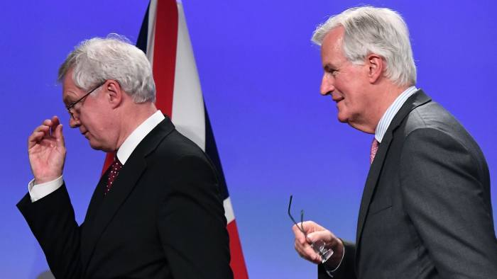 British Secretary of State for Exiting the European Union (Brexit Minister) David Davis (L) and European Union Chief Negotiator in charge of Brexit negotiations with Britain Michel Barnier (R) leave after addressing media representatives at the European Union Commission in Brussels on September, 28, 2017. The EU and the UK concluded a forth round of Brexit talks. / AFP PHOTO / EMMANUEL DUNANDEMMANUEL DUNAND/AFP/Getty Images