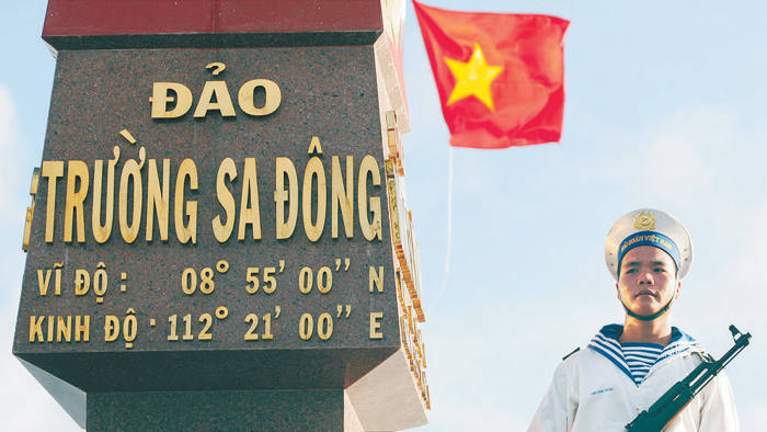 A Vietnamese naval soldier stands guard at Truong Sa Dong island in the Spratly archipelago January 7, 2013
