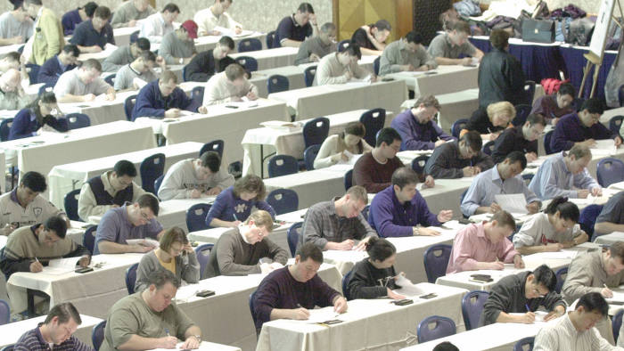 Candidates completing a Chartered Financial Analyst (CFA) exam