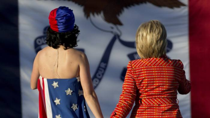 Pop singer Katy Perry and candidate Hillary Clinton on stage at the Jefferson-Jackson dinner in Iowa, October 2015