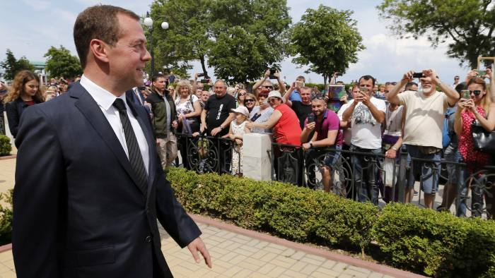 Russia's Prime Minister Dmitry Medvedev greets people as he visits the Aivazovsky National Art Gallery in Feodosiya (Feodosia), Crimea, May 23, 2016. Dmitry Astakhov/Sputnik/Pool via REUTERS ATTENTION EDITORS - THIS IMAGE WAS PROVIDED BY A THIRD PARTY. EDITORIAL USE ONLY.