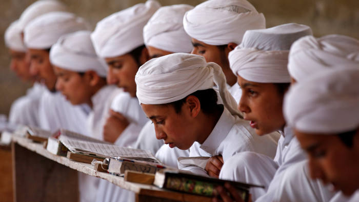 Boys read the Koran inside Markaz Al-Madrasa Al-Islamia, an Islamic seminary and orphanage, during the Muslim fasting month of Ramadan in Shadipora on the outskirts of Srinagar May 30, 2017. REUTERS/Danish Ismail