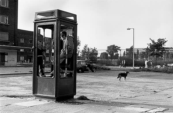 A vandalised phone box in Salford, 1986