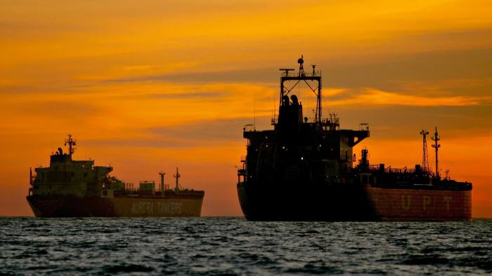 Tanker Glut Signals 25% Slump In Freight Rates This Year...Oil tankers are anchored near the Port of Long Beach, California, U.S., on Thursday, Dec. 31, 2009. A surplus of idled oil tankers, which would stretch 26 miles if lined up end to end, may signal a 25 percent slump in freight rates this year. The ships will unload 26 percent of the crude and oil products they are storing in six months, adding to vessel supply and pushing rates for supertankers down to an average of $30,000 a day, compared with $40,212 now. Photographer: Tim Rue/Bloomberg