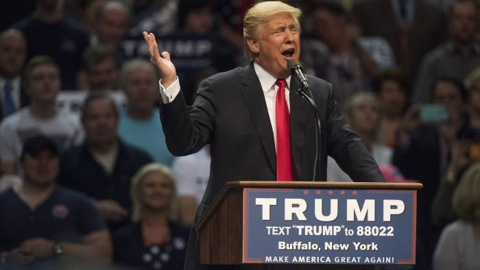 Donald Trump, president and chief executive of Trump Organization Inc. and 2016 Republican presidential candidate, speaks during a campaign event in New York, U.S., on Monday, April 18, 2016. Trump is accused in a lawsuit of inciting a