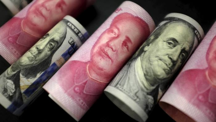 U.S. 100 dollar banknotes and Chinese 100 yuan banknotes are seen in this picture illustration in Beijing, China, January 21, 2016. REUTERS/Jason Lee/File Photo
