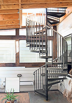 Spiral staircase leading to roof space