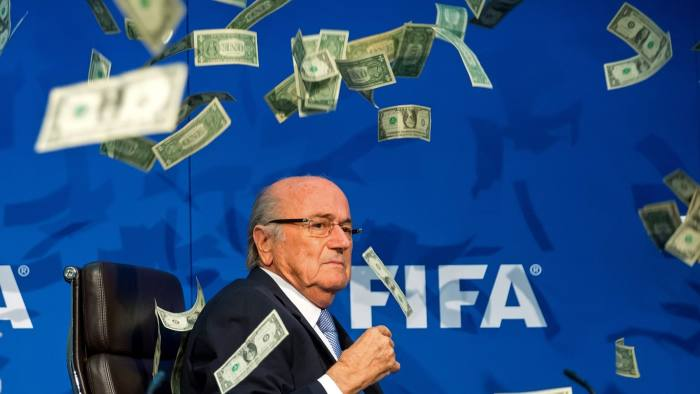 ZURICH, SWITZERLAND - JULY 20: A comedian attacked FIFA President Joseph S. Blatter with money during a press conference at the Extraordinary FIFA Executive Committee Meeting at the FIFA headquarters on July 20, 2015 in Zurich, Switzerland. (Photo by Philipp Schmidli/Getty Images)