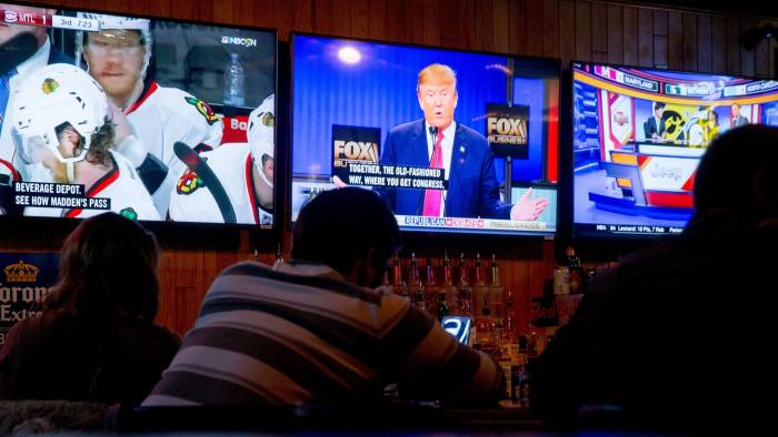 Republican presidential candidate Donald Trump is seen on a television at Wellman's Pub in Des Moines, Iowa, Thursday, Jan. 14, 2016, as he speaks during the Fox Business Network Republican presidential debate at the North Charleston Coliseum. (AP Photo/Andrew Harnik)