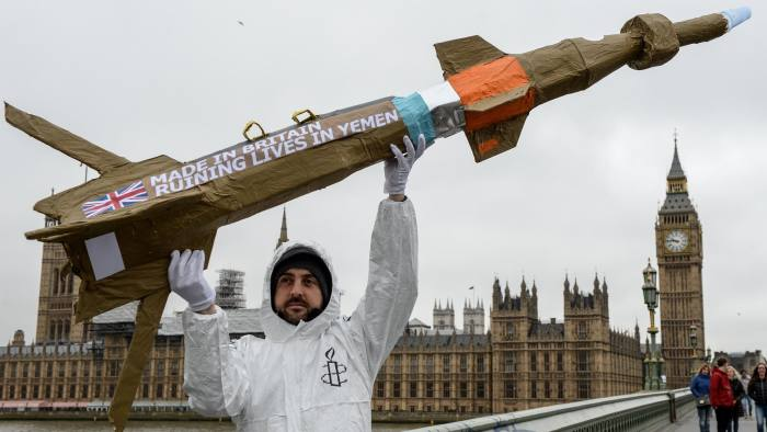 LONDON, ENGLAND - MARCH 18: Amnesty International activists march with homemade replica missiles bearing the message 'Made in Britain, destroying lives in Yemen' across Westminster Bridge, past Parliament and to Downing Street during a protest over UK arms sales to Saudi Arabia on March 18, 2016 in London, England. The missiles are replicas of the 500lb 'Paveway-IV' weapon which are currently used by Saudi Arabia's UK supplied Eurofighter Typhoon war planes. (Photo by Chris Ratcliffe/Getty Images)