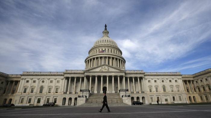 A lone worker passes by the U.S. Capitol Building in Washington, October 8, 2013. A few faint glimmers of hope surfaced in the U.S. fiscal standoff, both in Congress and at the White House, with President Barack Obama saying he would accept a short-term increase in the nation's borrowing authority to avoid a default. REUTERS/Jason Reed (UNITED STATES - Tags: POLITICS)
