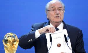 FILE - In this Thursday, Dec. 2, 2010 file photo FIFA President Sepp Blatter announces Russia to host the 2018 World Cup during the announcement of the host country for the 2018 soccer World Cup in Zurich, Switzerland. FIFA has cleared Russia and Qatar of any wrongdoing in their winning bids for the next two World Cups. (AP Photo/Michael Probst, File)