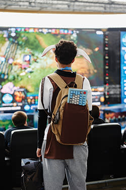 Cosplayer Maximilian McKone watches the games action on a big screen
