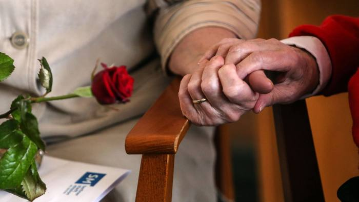 BESTENSEE, GERMANY - MARCH 14:  Elderly residents hold hands during the ten-year anniversary celebration of the Bestensee Senior Care Center (Seniorenzentrum Bestensee) on March 14, 2014 in Bestensee near Berlin, Germany. The assisted living center, which provides home, food, conversation and cultural diversion to elderly citizens, is run by the Berliner Stadtmission, a charity association led by the region's Evangelical church.  (Photo by Adam Berry/Getty Images)
