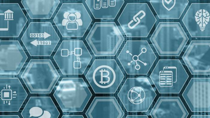 Bitcoin and blockchain symbols on a blue and grey background