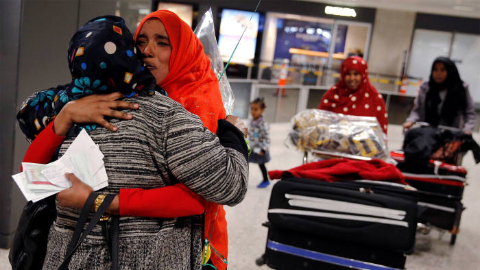 Najmia Abdishakur (2nd L), a Somali national who was delayed entry to the U.S. because of the recent travel ban, is greeted by her mother Zahra Warsma (L) at Washington Dulles International Airport in Chantilly, Virginia, U.S. February 6, 2017.  REUTERS/Jonathan Ernst