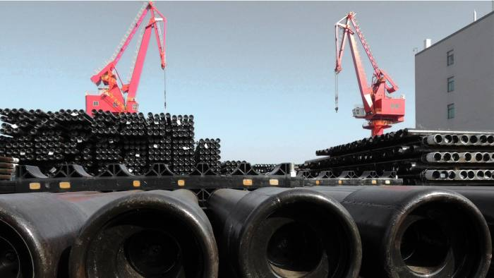 Steel pipes are seen at a port to be loaded onto ships for export to various countries in Lianyungang, eastern China's Jiangsu province on December 1, 2015. Chinese manufacturing activity contracted at its fastest rate for more than three years in November, official data showed on December 1, underlining weakness in the world's second-largest economy. CHINA OUT AFP PHOTO / AFP / STR (Photo credit should read STR/AFP/Getty Images)