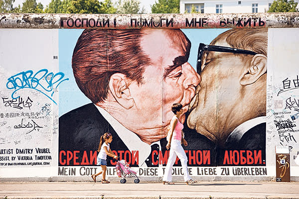 Graffiti mural on the BerlinWall featuring the famous kiss between Erich Honecker and Leonid Brezhnev in 1979
