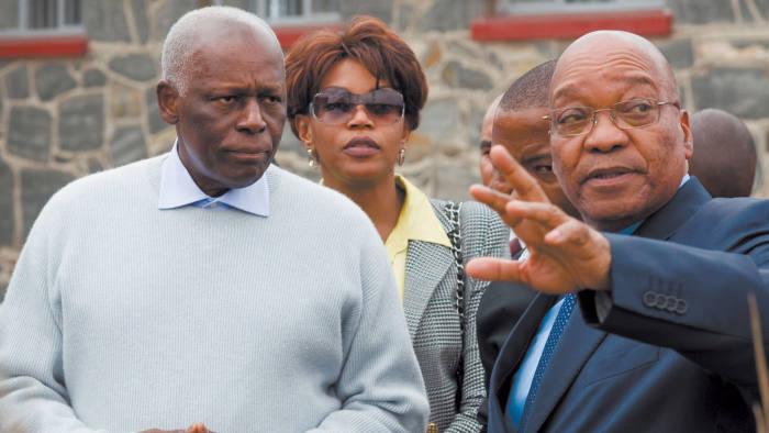 Angolan President Eduardo Dos Santos (left) accompanied by South African President, Jacob Zuma (right)