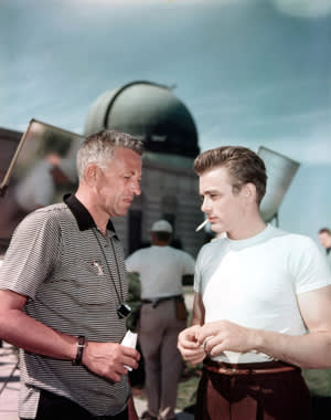Director Nicholas Ray talking to James Dean at the Griffith Park Observatory in between scenes from the film 'Rebel Without A Cause', 1955.