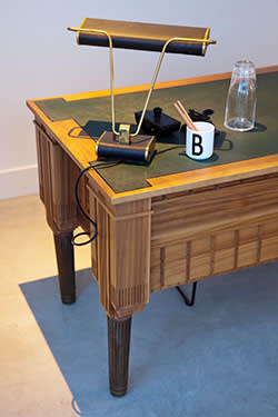 A desk in the show flat, resembling the power plant upside down