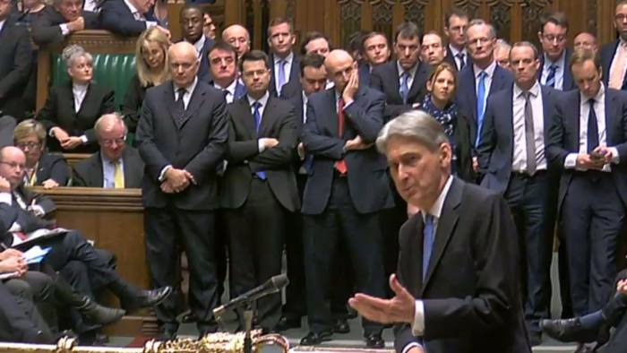 """A video grab from footage broadcast by the UK Parliament's Parliamentary Recording Unit (PRU) shows Britain's Chancellor of the Exchequer Philip Hammond as he presents his budget statement in the House of Commons in London on November 22, 2017. Britain's Conservative government unveils its annual budget Wednesday, against the backdrop of looming Brexit and sluggish economic growth. Hammond is set to vow to """"invest to secure a bright future for Britain"""" according to excerpts of his keynote speech, in a hint he may be ready to start bringing down the curtain on unpopular austerity. / AFP PHOTO / PRU AND AFP PHOTO / HO / RESTRICTED TO EDITORIAL USE - MANDATORY CREDIT """" AFP PHOTO / PRU """" - NO USE FOR ENTERTAINMENT, SATIRICAL, MARKETING OR ADVERTISING CAMPAIGNSHO/AFP/Getty Images"""